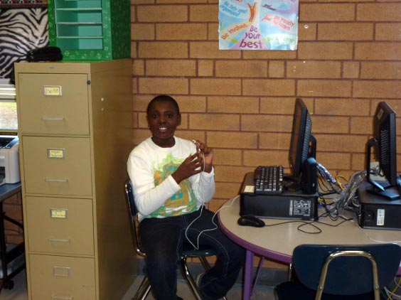 boy at a computer in a classroom