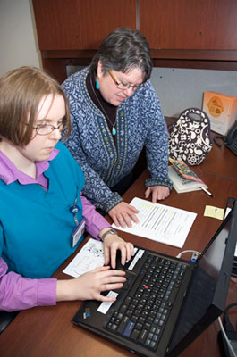 researchers working on a computer