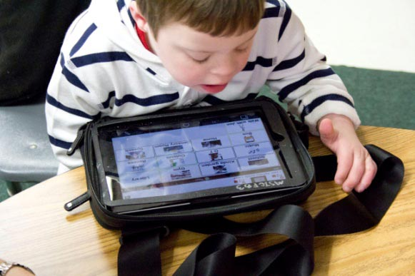 young male student using a tablet computer